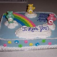 Care Bear Cake This is a 1/4 sheet cake. Flavor was lemon with Lemon Buttercream icing. For a young lady that loved Care Bears from her Grandmother.