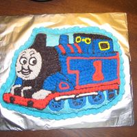 Thomas The Tank My second attempt at this cake...this one came out much better than the first. I used the Thomas cake pan.
