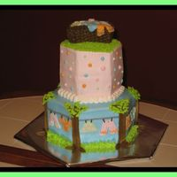 "Clothes Line I saw this cake here on CC. Thanks it was a big hit at the Baby Shower. I used a 10"" and a 6"" hexagon pans and the clothes basket..."
