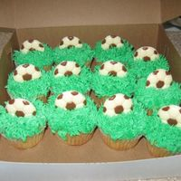 Soccer Cupcakes  Made for the kids' soccer team. I filled them with marshmallow fluff and the kids LOVED them! I made the soccer balls out of chocolate...