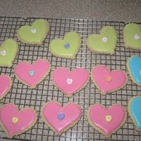 V-Day Cookies   Quick cookies for my son's Pre-K Valentine's party. NFSC with Antonias royal icing. Little conversation heart in the middle.