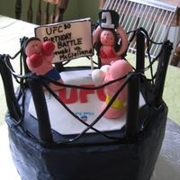 Ufc Buttercream with fondant figures, black licorice ring