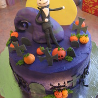 Nightmare Before Christmas Nightmare before Christmas cake - buttercream cake, fondant pumpkins and headstones. The curvy purple thing is made from Rice Krispie cake...