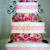 Pink And White Monogram Fresh roses, satin ribbon, and buttercream