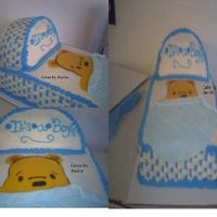 Bassinet Pooh  Cake done for my cousins baby showerBig thank to mcassada and the cc boardcake is 11x 13 2 layer, 9.5 round for top, used pin prick method...