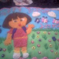 Dora Flower Garden  This is my first cupcake cake order, 75 cupcakes decorated with all buttercream. Dora is done with star tip. The picture is not a good one...