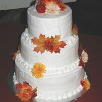 Anniversary Cake This was my first stacked cake. This was a cake for my friends 25th wedding anniversary. She help keep it simple by using fall flowers to...