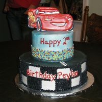Cars 2 tier cake with color flow McQueen.
