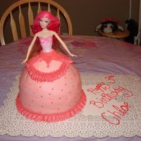 "Barbie Cake My daughter of course is a Barbie Fanatic! This was my first doll with the wonder mold pan. I also have an 8"" on the bottom of it, as..."