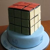 Another Rubik's Cube!   Rubik cube, and base cake covered in fondant. Fondant squares.