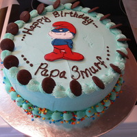 "Papa Smurf Birthday Cake 10"" round carrot cake with, cream cheese filling and buttercream icing. Papa Smurf is made from fondant. Thanks for looking. :)"