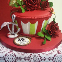 Mad Hatter Ruby Wedding Anniversary Chocolate Mad Hatter cake for a couple celebrating their 40th Wedding Anniversary. Gumpaste roses and leaves, and gumpaste anchor and life...