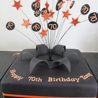 Black & Orange Starburst Cake Black satinice, and gumpaste stars.