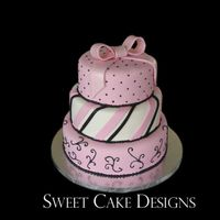 Pink Bow Fondant covered cake (12, 10, and 8 inch) with gumpaste bow dusted with pearl dust. Royal icing scrolls and beading. Thank you to...