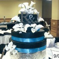 Black And Turquoise Chocolate cake with black buttercream- artificial ribbon, callas and stephanotis