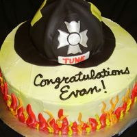 They Call Me The Fireman...   Cake for fire school graduate. Dark Chocolate fudge with buttercream filling. Buttercream icing and gumpaste/fondant helmet. TFL!
