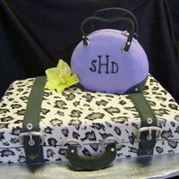 Purse And Suitcase This was done to resemble a pic that client brought me, but with different colors, etc. Fondant with gumpaste accents, and handpainted...