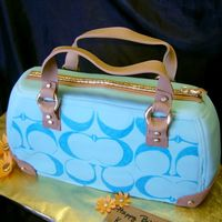 Teal Coach Purse WASC covered in fondant with gumpaste details!