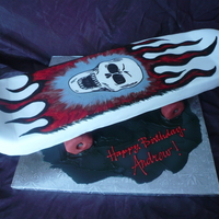 Skateboard Fondant covered skateboard cake with cereal treat wheels.and handpainted skull and flames. Fun one to make!