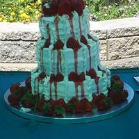 Strawberry Tower This wedding cake was done in Phoenix, AZ in early June. By the time I got the cake to the reception it had started leaning. Maybe it was...