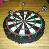 "Dart Board Well it's not a regulation size, but it was darn near close. It ended up being a 14"" round. All done in butter cream frosting...."