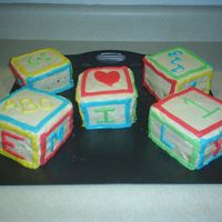 Daughter's 1St B-Day This was for my daughter's 1st birthday. I learned so much doing this cake. 1. Place one block on the board at a time. 2.Take your...