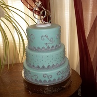 Blue Scrolls cake is covered in fondant and has gum paste scrolls and silver dragees