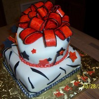 Orange Bow cake is covered with chocolate fondant and the bow is made of gum paste