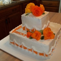 Orange Roses butter cream frosting with gum paste roses