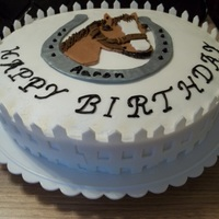 Horse With Picket Fence cake is covered in butter cream with fondant decorations