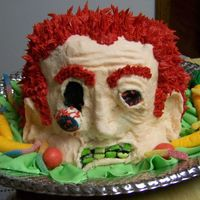 Zombie   carved head, with crusting buttercream frosting. fondant veggies