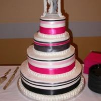Wedding_1.jpg This was my first wedding cake. Please keep in mind, that I did NOT pick the colors. Other than the colors, I was very happy with the...
