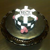 Poker Chips This was a tiny cake made to look like the World Series of Poker logo. It is covered in ganache with fondant accents.