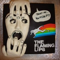 The Flaming Lips This was a cake I made for the band The Flaming Lips. It was modeled after the poster for their new year's eve concert. The hands were...