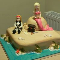 Pirates And Mermaids  This cake was for a little girl having a pirate and mermaid party. She wanted lifelike models of her in a mermaid costume and her sister as...