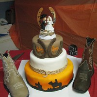 Cowboy Wedding The boots are rice krispie treats and are life size replicas of the boots they were wearing on their wedding day