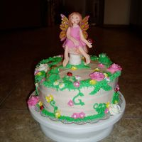 Fairy In A Forest Cream cheese frosting w/buttercream and fondant decorations. For my 6 year old's birthday