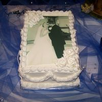The Kiss  Buttercream icing on a 9x13 with a edible image. This cake works great for a 1st anniversary cake. (Picture from the wedding show I was in...