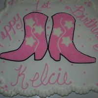 Cowgirl Birthday Party Cupcake Cake For some friends little girl that was turning one. I didn't like the way the boots turned out, wish I could of found something that...