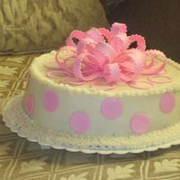 Img_8885.jpg polka dots n bow are gumpaste vanilla cake covered in bc cream