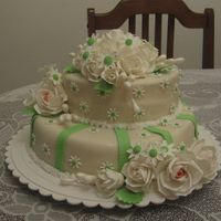 For A Couple Who Is Celebrating Their 15 Years Anniversary. vanila cakes covered in mmf. Roses rnd daisies are made of gumpaste.