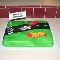 Race Car Track   Buttercream frosted vanilla cake with fondant road and name.