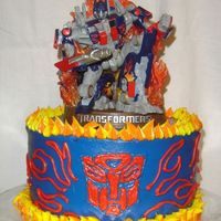 Optimus Prime Made this for my son's birthday in November. All buttercream, bought the topper for him to keep.