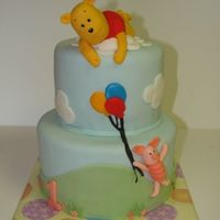 "Pooh In The Clouds 6"" & 8"" cakes covered with mmf. I made the figures with rkt and mmf. This was a 1st birthday cake for a little girl, hence..."