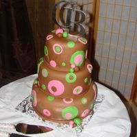 Brown Pink And Green Dots A cake decorated with chocolate fondant...this was done for a bride that I babysat as a baby...that's when you know your getting old...