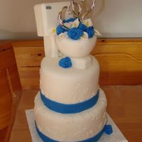 A Plumber's Wedding This is a small wedding cake I did for a plumber. I made the topper from styrofoam and covered it with mmf. Flowers and all the rest of the...