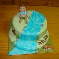 "Diego Cake 8"" cake on top of a single layer of a 10"" cake, all covered together. All decoration done out of mmf, waterfall is mmf painted..."