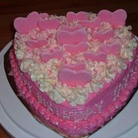 Jazmine's B'day my kids are my heart, so of course jazmine's b'day cake had to be full of them. french vanilla buttercream icing.