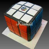 Rubik's Cube My son's B-day cake wasc with chocolate pudding and whipped cream filling. BC w/fondant tiles.