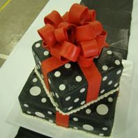 Another Present Black, white, and red present. Buttercream w/ fondant accents.